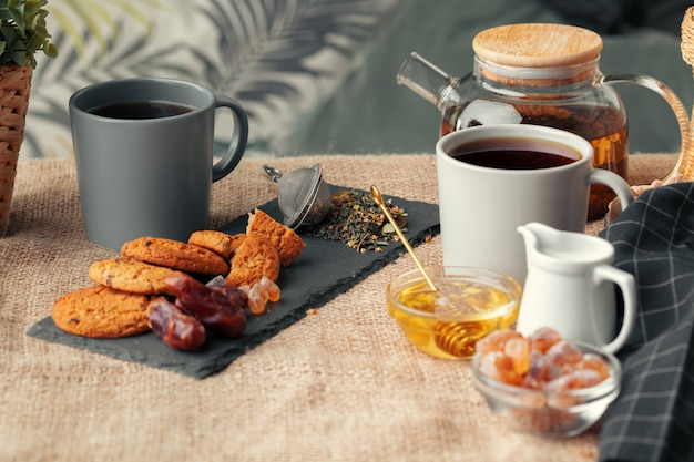 Chinese tea teapot lemon ginger honey on light tablecloth. tea ceremony Premium Photo