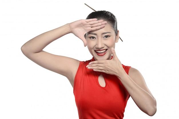 Chinese woman in cheongsam dress Premium Photo