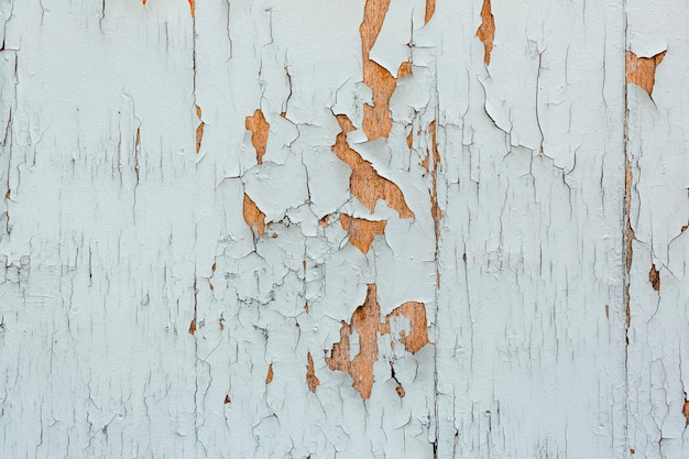 Chipping paint on worn wooden surface Free Photo
