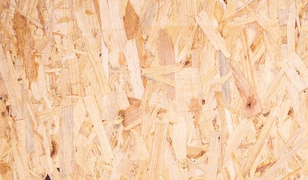 リサイクル圧縮木材chippingsボード抽象的なテクスチャ背景のクローズアップ Premium写真