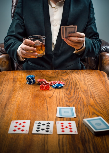 The chips for gamblings, drink and playing cards Free Photo