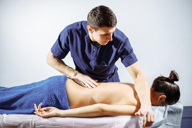 Chiropractic, osteopathy, dorsal manipulation. Premium Photo
