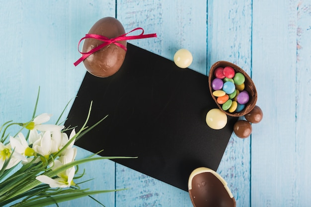 Choco eggs and blank paper Free Photo