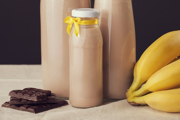 Chocolate banana flavored yogurt on the table Premium Photo