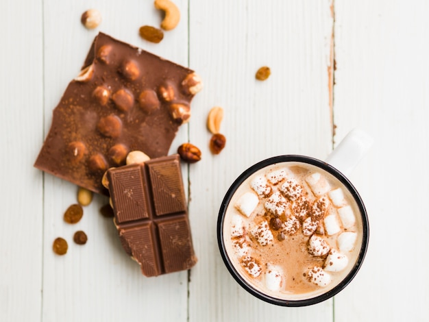 Chocolate bar with nuts and mug of cocoa with marshmallows Free Photo