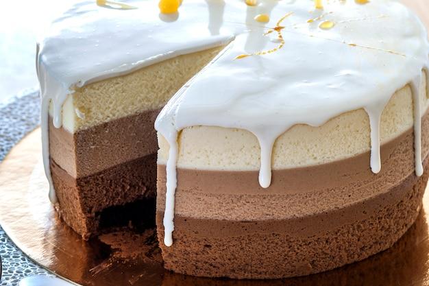 Chocolate birthday cake decorated with colorful stripes Premium Photo