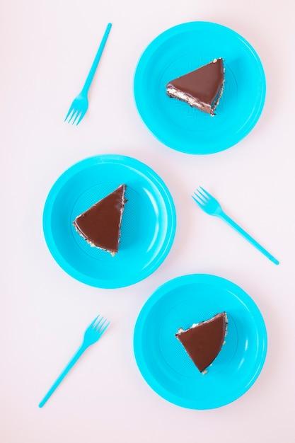 Chocolate birthday sliced cake on plates Free Photo