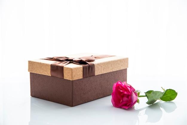 Chocolate box gift and rose Free Photo