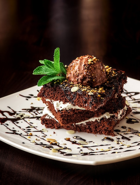 Chocolate brownie cake with a scoop of ice cream. Free Photo