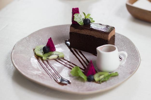 Chocolate cake in the coffee shop Premium Photo