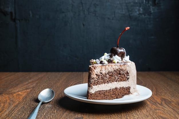 Chocolate cake on old wood table Premium Photo