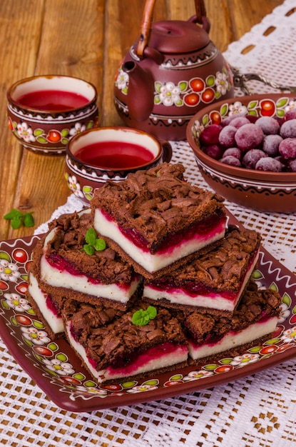Chocolate cake with cottage cheese and cherry Premium Photo