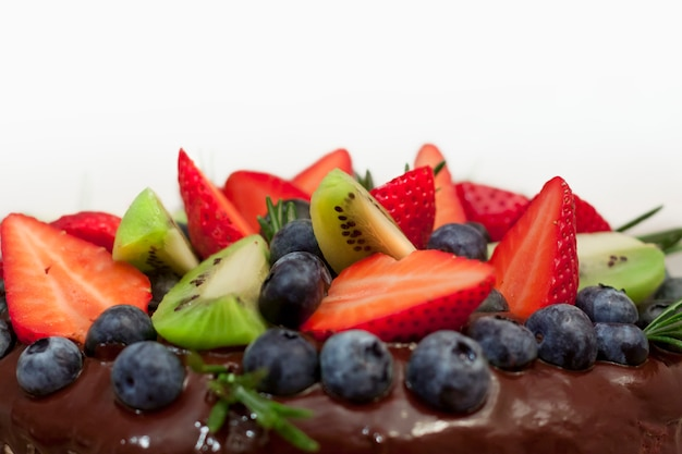 Chocolate cake with fruits decoration on Photo   Premium Download