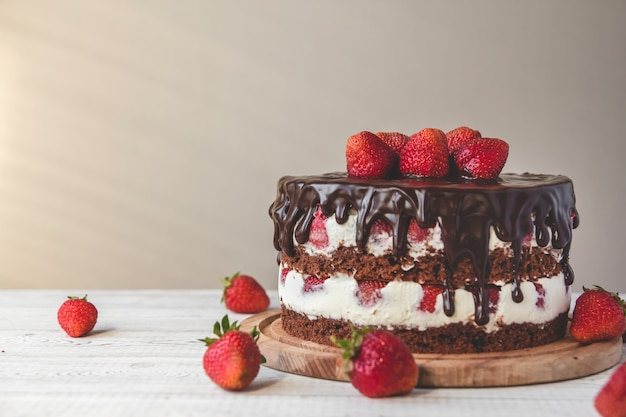 Chocolate cake with strawberries on the table Premium Photo