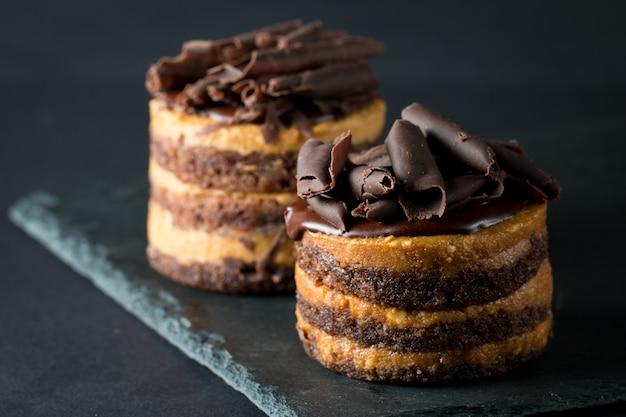 Chocolate cakes on black board Premium Photo