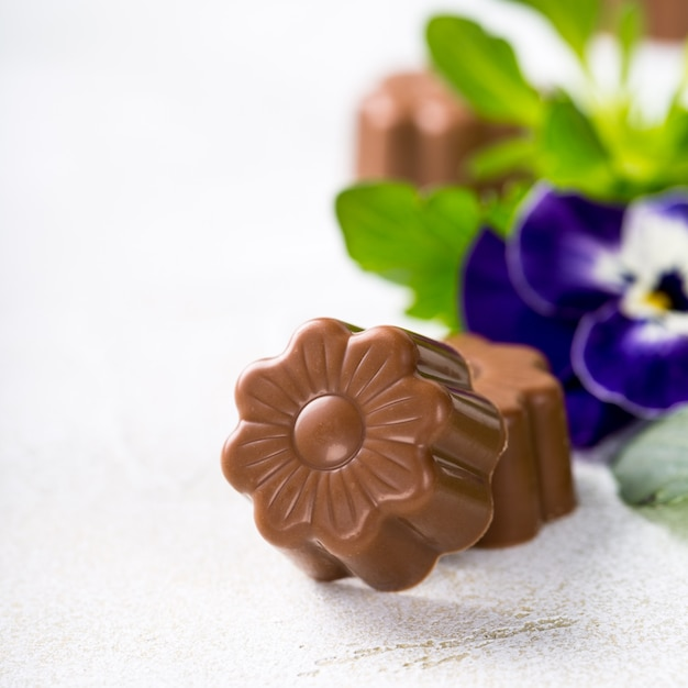 Chocolate candies in flower shape Premium Photo