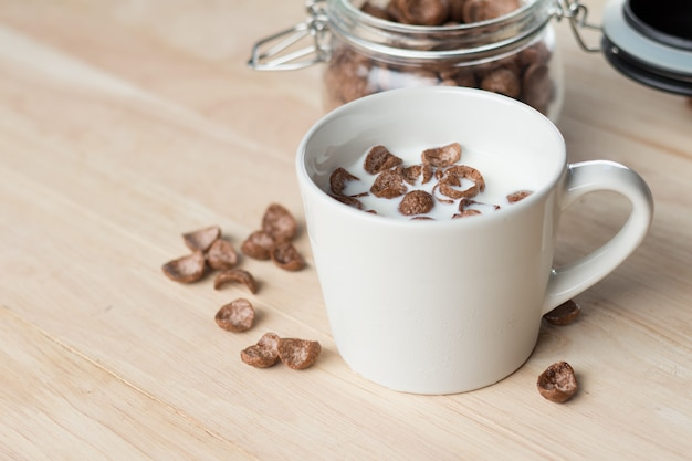 Chocolate cereal cornflakes and milk for breafast Premium Photo