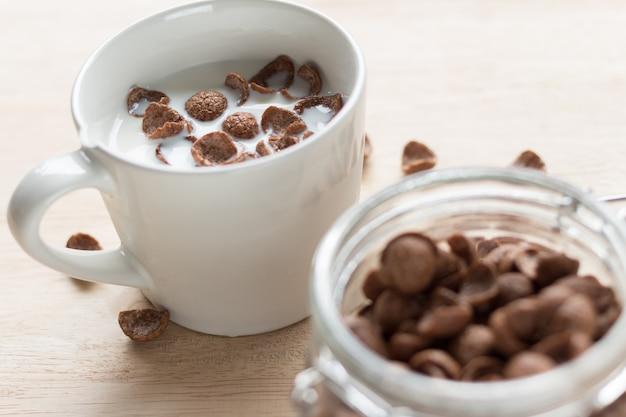 Chocolate cereal cornflakes and milk for breafast Premium Photo