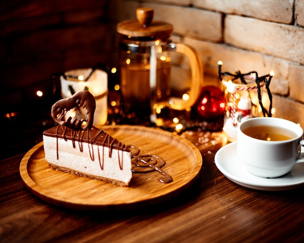 Chocolate cheesecake and a cup of flavored tea Free Photo