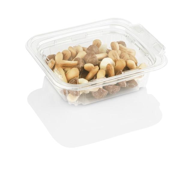 分離された透明な箱の中のキノコのような形をしたチョコレートチップクッキー Premium写真