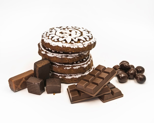Chocolate cookies; ball and bar on white background Free Photo