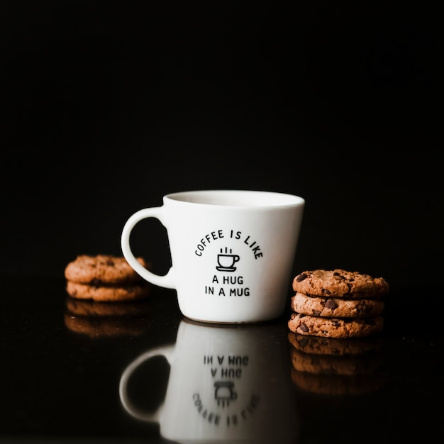 Chocolate cookies and ceramic cup on black background Free Photo