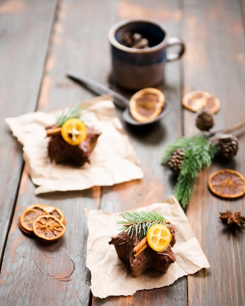 Chocolate covered sweets with dried citrus and cinnamon Free Photo