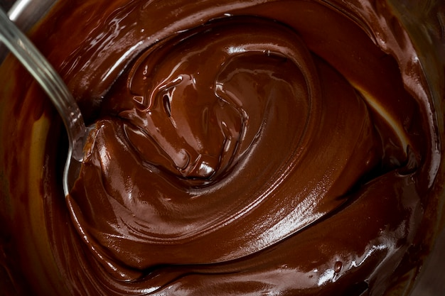 Chocolate cream and a spoon Free Photo