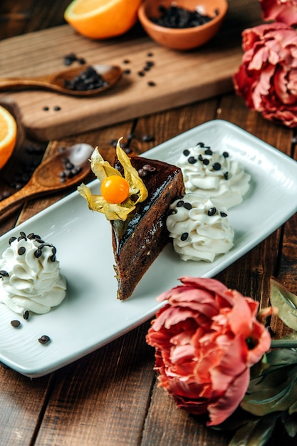 Chocolate dessert with side cream Free Photo