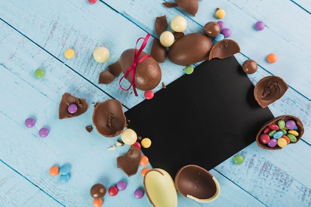 Chocolate Easter eggs and paper card Free Photo