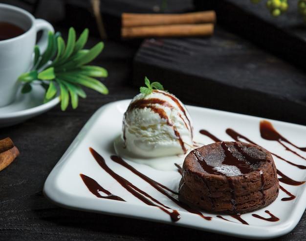 Chocolate fondue with icecream ball Free Photo