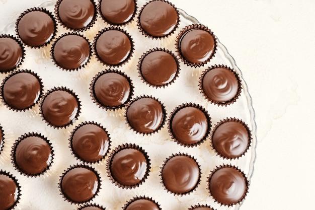 Chocolate ganache candy with almonds  pouring chocolate homemade dessert Premium Photo