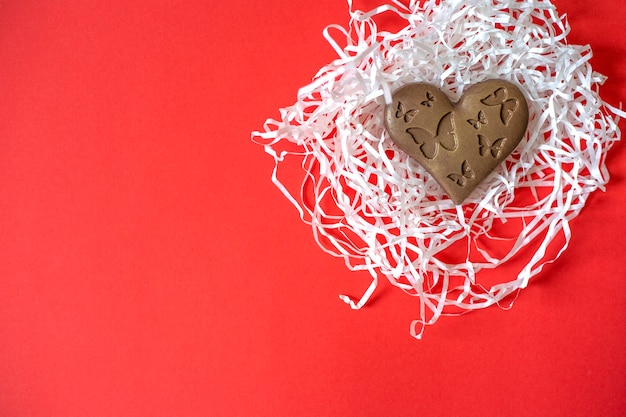 Chocolate heart with butterflies. valentine's day. heart shaped chocolate Premium Photo