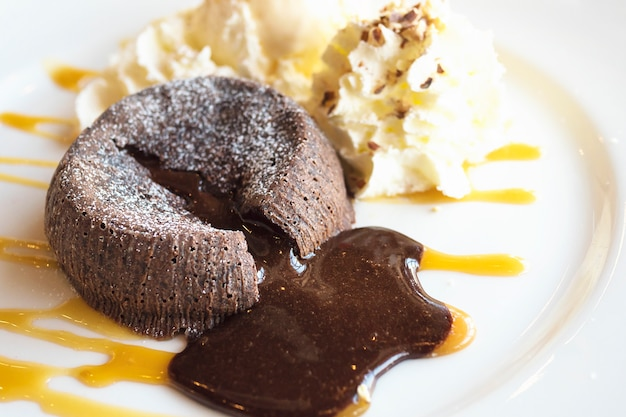 Chocolate lava cake in white plate Free Photo