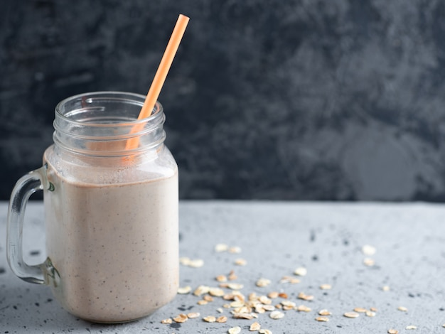 Chocolate milk smoothie with oatmeal nuts and cinnamon. healthy breakfast Premium Photo