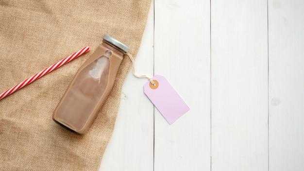 Chocolate milk on a white wooden table. Premium Photo