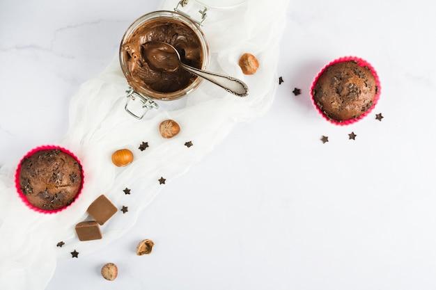 Chocolate muffins and cream Free Photo