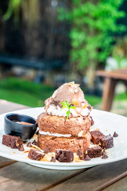 Premium Photo Chocolate Pancake With Chocolate Ice Cream And Brownies