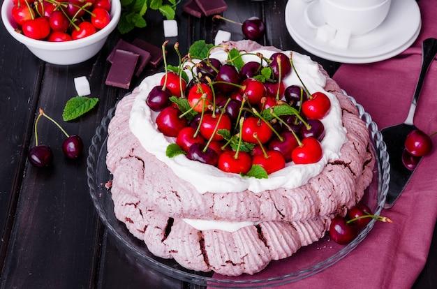 Chocolate pavlova cake with whipped cream and cherries. australian and new zealand cuisine. Premium Photo