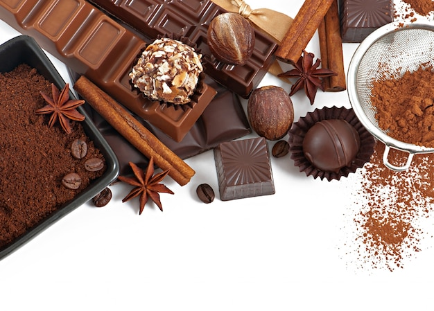 Chocolate and spices isolated on white Free Photo