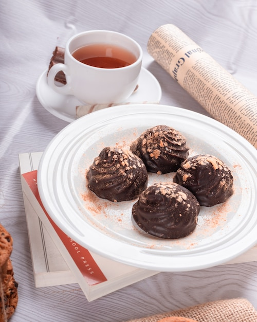 Chocolate and tea on the table Free Photo