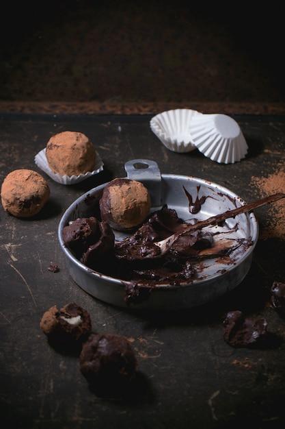 Chocolate truffles on concrete Premium Photo