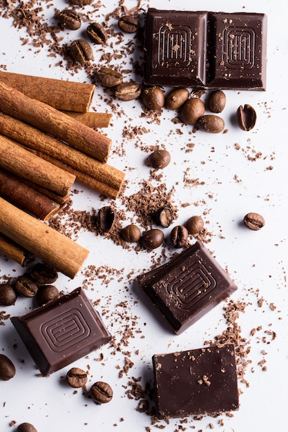 Chocolate with cinnamon and coffee beans Free Photo