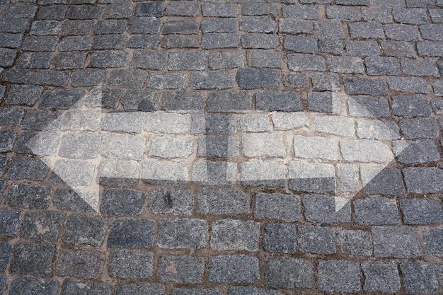 Choices concept, pavement crossroad with arrows. Premium Photo