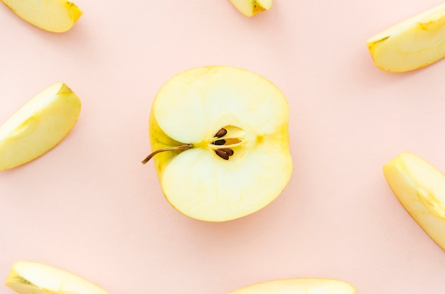 Chopped apples on pale pink background Free Photo