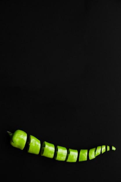Chopped fresh green chili pepper on black background Free Photo