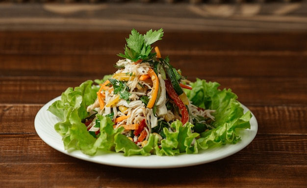Chopped and minced chicken mushroom salad with colorful bell peppers and fresh parsley Free Photo