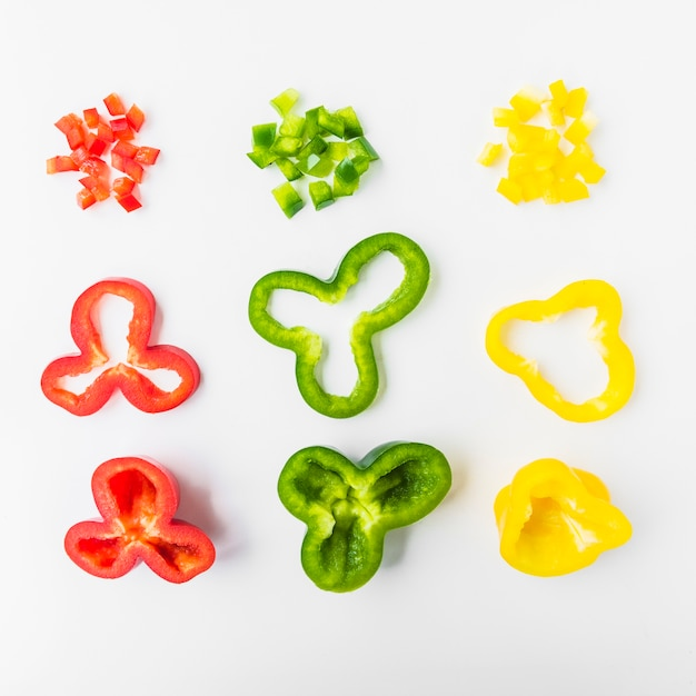 Chopped red; green and yellow bell peppers on white background Free Photo