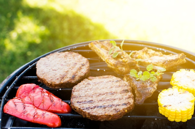 Chops pepper meat corn on grill pan Free Photo