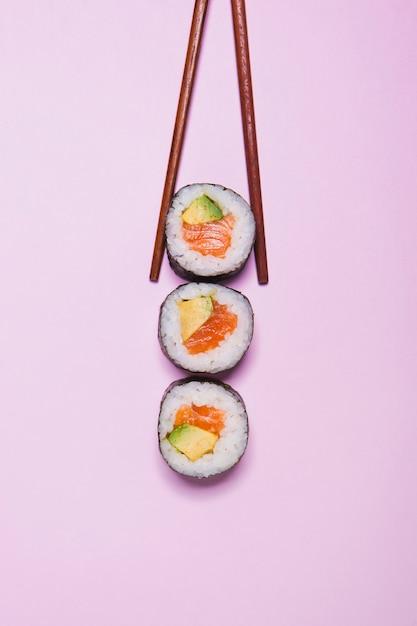 Chopsticks taking sushi Free Photo